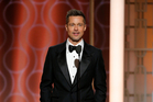 Brad Pitt was greeted with rapturous applause when he took to the stage at the Golden Globes last night. Photo/AP