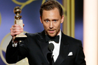 Tom Hiddleston with the award for best actor in a limited series or TV movie for The Night Manager at the 74th Annual Golden Globe Awards. Photo / AP