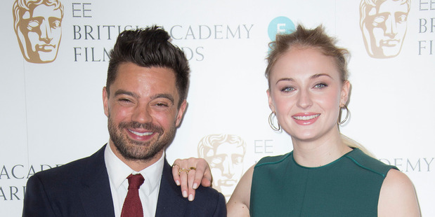 Actors Sophie Turner, right, and Dominic Cooper pose for photographers after announcing the nominations for the EE British Academy Film Awards in 2017. Photo/AP