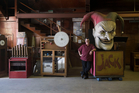 Jeff Shadic, manager of Park Decor and Visual Display, stands among some of the items being auctioned off by Knott's Berry Farm in Buena Park. Photo / AP