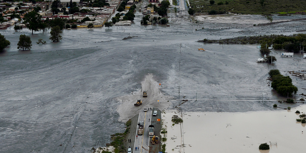 A flooded road is covered in mud after a landslide triggered by a storm in the village of Volcan, Argentina. Photo / AP