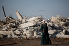 An Israeli Arab woman stands by the rubble of demolished house in Kalansua, Israel. Photo / AP