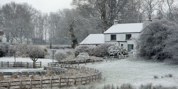 A snow covered house is seen in County Antrim, Northern Ireland. Photo / AP