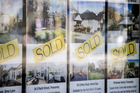 Auckland house sales and prices fell last month as the country's biggest city continued to enjoy a glut of properties on the block. Photo / File