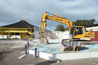 CLEARING THE WAY: Demolition underway in Mount Maunganui to make way for a shopping centre. Photo / File