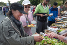 People are served their final dinner at Takahanga Marae in Kaikoura on November 20. Photo / Alan Gibson