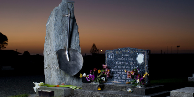 The Strongman Mine disaster memorial in the Karoro cemetery in Greymouth. A banjo shovel is fixed on the stone which commemorates the 19 men who died in the blast 50 years ago next week. Photo / File