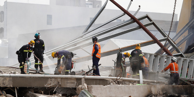 Rescue teams at work on rubble at the site of the CTV Building which collapsed in the 2011 earthquake in central Christchurch. Photo / Mark Mitchell