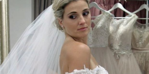 Gemma Flynn trys on a wedding dress on the Australian reality TV show Say Yes to the Dress.