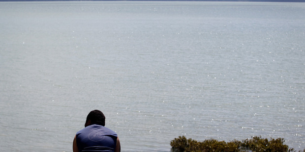 A fisherman spent five hours in the Manukau Harbour last night after his dinghy was swamped. Photo / File