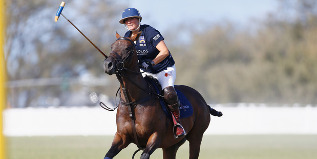 Zara Phillips in action at the Magic Millions Polo Event. Photo / Getty Images