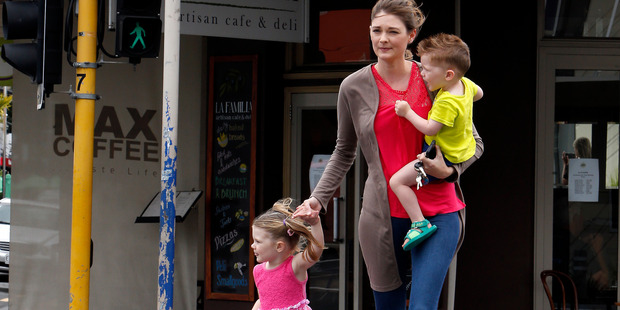 Lacey Owen,  with 2-year-old Declan and Calais, 3, wants drivers to take more care around pedestrians after her children were nearly hit last week.