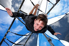 Tom Hughes, 13, from Maunu was hanging upside down in the shaded area of the Town Basin playground yesterday, staying cool but enjoying the summer weather in Whangarei. Photo / Michael Cunningham