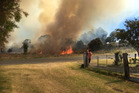 FAST-MOVING: Bright orange fire and thick black smoke envelop the land in Sunday's fire at Mahia. PHOTO SUPPLIED