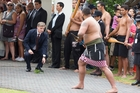 Bill English accepts an offering at the Te Tii Marae in Paihia on Waitangi Day 2015 when he was Deputy PM. Photo / Jason Oxenham
