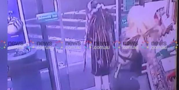 The woman steps over Ms Hacker with the axe and leaves the 7-Eleven premises while Ben Rimmer sits stunned in his own blood on the shop floor. Photo / News.com.au