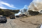 A fire at Mahanga Beach on Mahia Peninsula has destroyed one home and prompted the evacuation of other residents. Video/Sarah Young