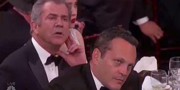 Loading Mel Gibson and Vince Vaughn glare daggers through Meryl Streep's Golden Globes anti-Trump speech. Photo / NBC