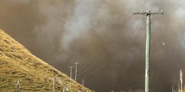 Smoke billows into the sky. Photo / Karen McGregor