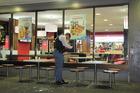 Police investigate last night's fight at McDonald's in Napier. Photo / Doug Laing