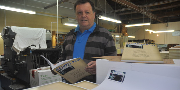 Strongman Mine historian Peter Ewen with copies of the new book, Pictures Past - Strongman's Men and 1967 Remembered, hot off the pres at James Print.  Photo / Greymouth Star