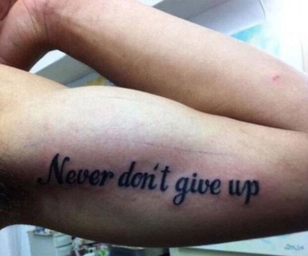 The motivational slogan to 'never give up' also fell rather flat after an unnecessary 'don't' was thrown in for good measure. Photo / @officialbigredfro