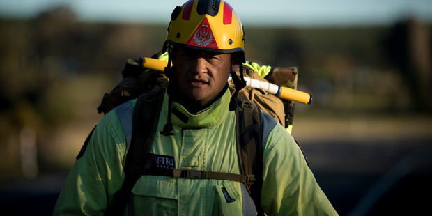Loading Firefighter and former soldier Maaka McKinney working his way towards Taupo. Photo / Dean Purcell