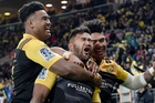 Hurricanes' Vince Aso celebrates his try with the Savea brothers. Photo / Photosport
