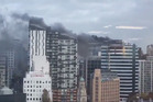 A massive fire on the corner of Mayoral Drive and Queen St in central Auckland today.