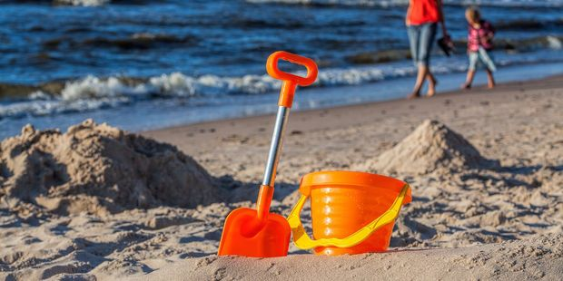 A family holiday at a familiar beach is all most children require, according to a child psychologist. Photo / 123RF