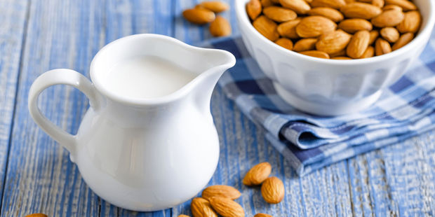 Almond milk has been proven to contain less nutrients than cows milk. Photo / 123rf
