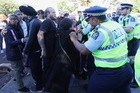Protesters have erupted in a violent scuffle outside a National Party conference. Photo / Jason Oxenham