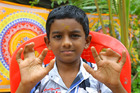 Seven-year-old Advaith is one of 140 people in his family with fingers that they believe are the result of
