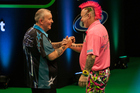 Phil Taylor (left) and Peter Wright are confirmed for Auckland, but will Michael van Gerwen be joining them. Photo / Photosport