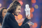 Salvador Sobral from Portugal celebrates as he holds the trophy after winning the Final of the Eurovision Song Contest. Photo/AP