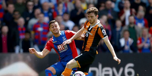 Crystal Palace's Joel Ward , left and Hull City's Andrew Robertson battle for the ball. Photo / AP