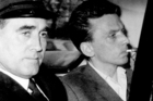 Ian Brady, right, is escorted to the courthouse in Hyde, Cheshire, England, in 1965. Photo / AP