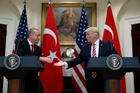Recep Tayyip Erdogan (left) and Donald Trump were full of praise for each  other as they spoke in the Roosevelt Room at the White House. Photo / AP