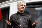 Assange calls it a great victory as the investigation into rape claims are dropped in Sweden
