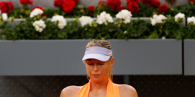 Maria Sharapova sits in a break during her a match at the Madrid Open. Photo / AP