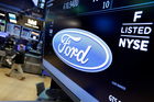 Ford Motor Company appears above a post on the floor of the New York Stock Exchange. Photo / AP