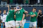 Ireland celebrate a try against the All Blacks in Chicago. Photo / Brett Phibbs