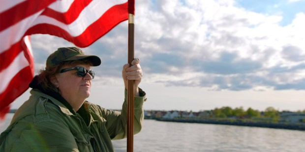 Michael Moore is taking on Donald Trump for his latest movie. Photo/AP