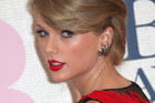 Taylor Swift sent a fan flowers and a handwritten note after skipping her graduation party. Photo/AP