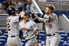 Houston Astros' Yuli Gurriel is congratulated by Josh Reddick and Carlos Correa. Photo / AP