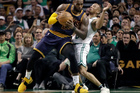 Cleveland Cavaliers forward LeBron James, left, muscles his way to the basket as Boston Celtics guard Avery Bradley, right, tries to defend. Photo / AP