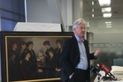 Internal Affairs Minister Peter Dunne announces Archives NZ funding in front of a painting of Red Cross women who served in World War I. PHOTO/Gia Garrick