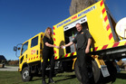 Otago Rural Fire Authority deputy principal fire office Pete Scarlet hands the keys for the Makarora Volunteer Fire Brigade's new custom-built fire engine to fire chief Heather Pennycook yesterday. Photo / Tim Miller.