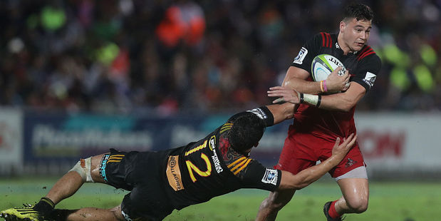 David Havili of the Crusaders is tackled by Anton Lienert Brown of the Chiefs. Photo / Getty