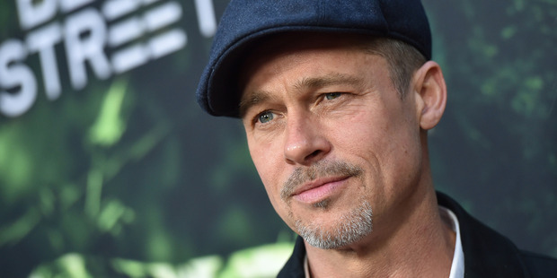 Brad Pitt arrives at the premiere of The Lost City of Z earlier this year. Photo / Getty